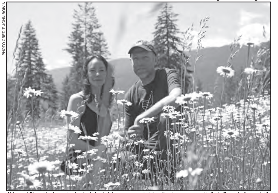 Black and white photo of a couple in a field of flowers